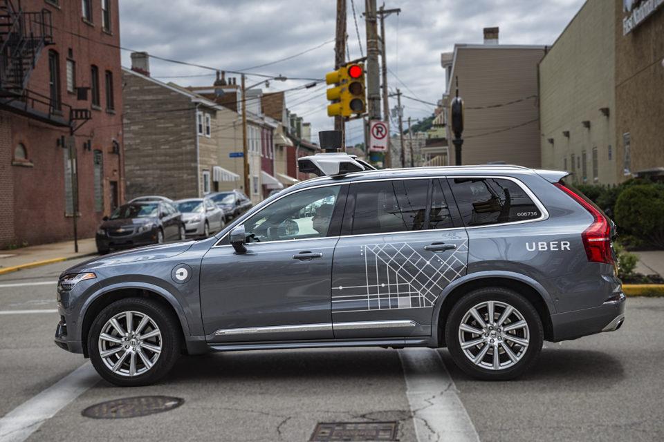Uber suspends program after self-driving car killing