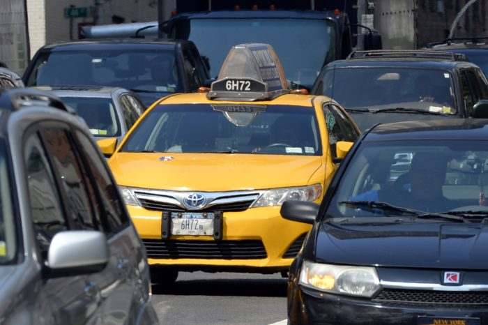 New York imposes restrictions on Uber