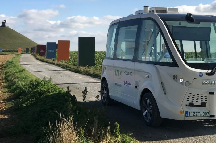 Self-driving shuttle at foot of Lion of Waterloo